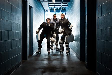 corridors: Three businessmen wearing ice hockey uniforms