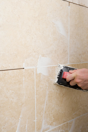 home decorating: A decorator grouting tiles
