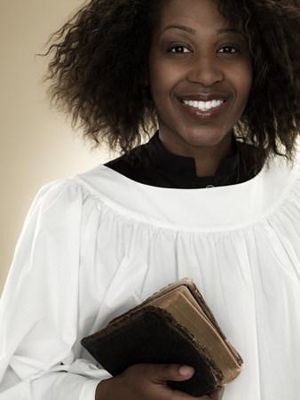 vestment: A gospel singer holding a bible