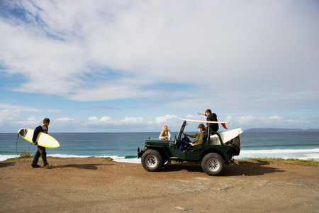 Surfers with off road vehicle LANG_EVOIMAGES