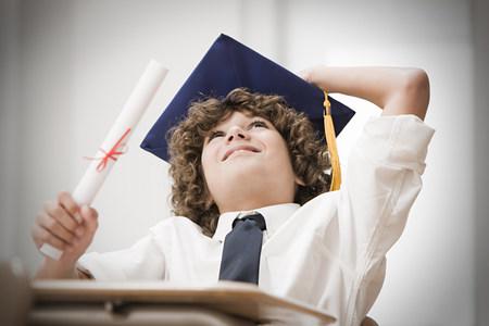 higher intelligence: Graduating boy looking up LANG_EVOIMAGES