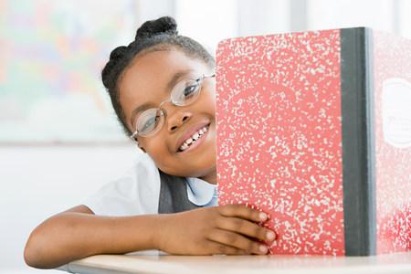 Schoolgirl smiling LANG_EVOIMAGES