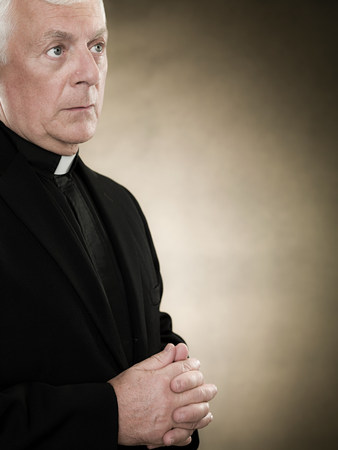 ponderous: A priest praying LANG_EVOIMAGES