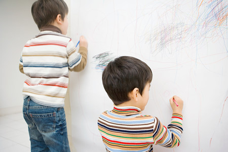 two persons only: Boys drawing on a wall