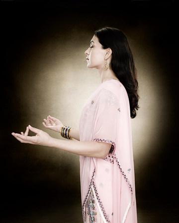 matures: A hindu woman meditating