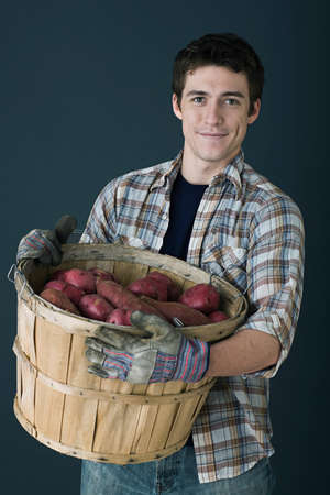 farmyards: Man with container of potatoes