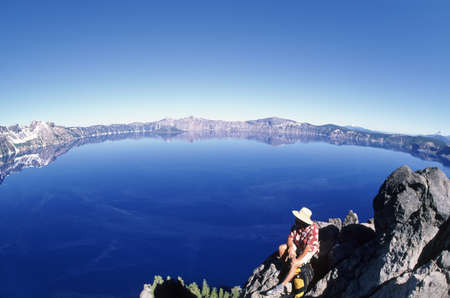 crater lake: Hiker by crater lake