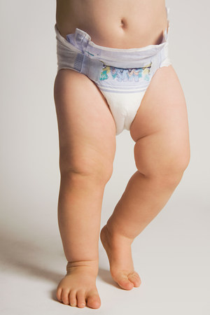 A baby wearing a nappy LANG_EVOIMAGES