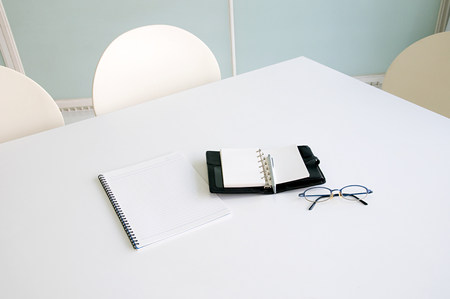 Eyeglasses and diary on a table LANG_EVOIMAGES