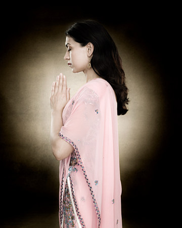 A hindu woman praying