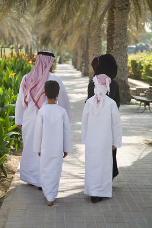 age 20 25 years: Rear view of a family walking