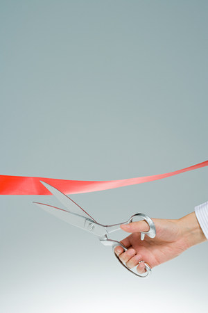 two persons only: Person cutting ribbon LANG_EVOIMAGES