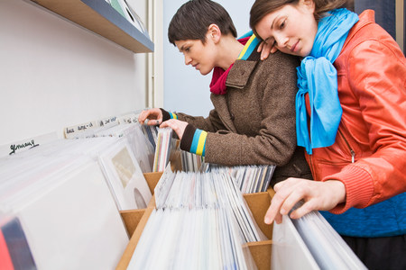 A lesbian couple looking at records LANG_EVOIMAGES