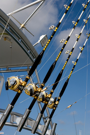 four objects: Fishing rods and reels.