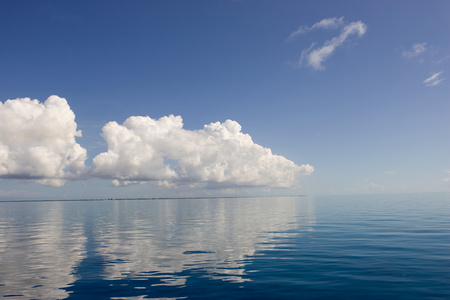 Clouds above calm ocean.