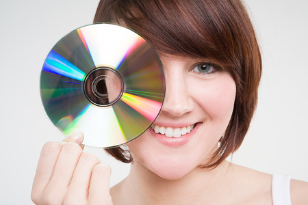 A teenage girl holding a cd LANG_EVOIMAGES