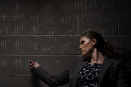 shadowed: Businesswoman and chalk marks on wall