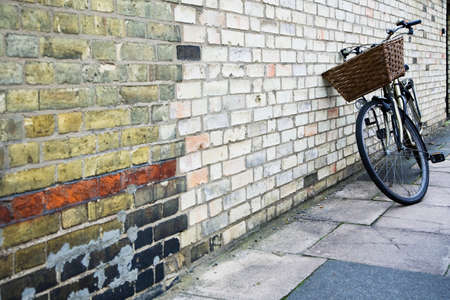 way out: A bicycle leaning against a wall LANG_EVOIMAGES