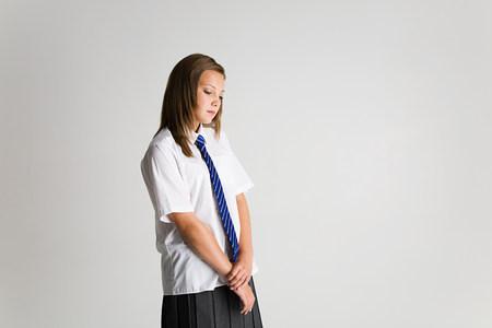 inaccessible: Schoolgirl looking sad