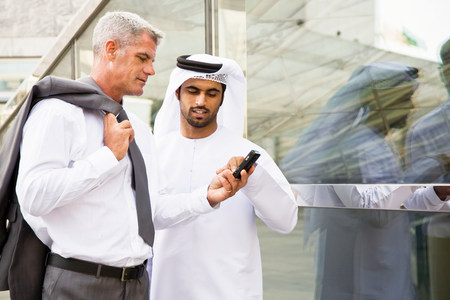 A businessman showing cell phone LANG_EVOIMAGES