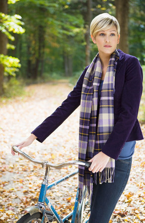 transportation: Young woman with bike