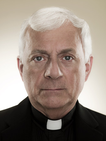 looking at viewer: A headshot of a priest LANG_EVOIMAGES