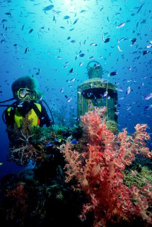 Scuba diver on shipwreck.