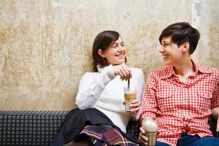 pleasurable: A lesbian couple having coffee LANG_EVOIMAGES