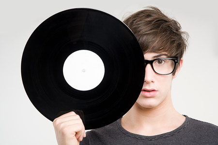 lps: A teenage boy holding a vinyl record
