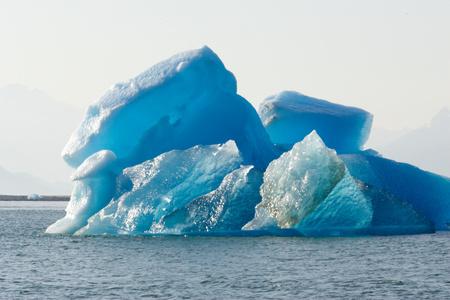 calved: Iceberg calved from glacier. LANG_EVOIMAGES