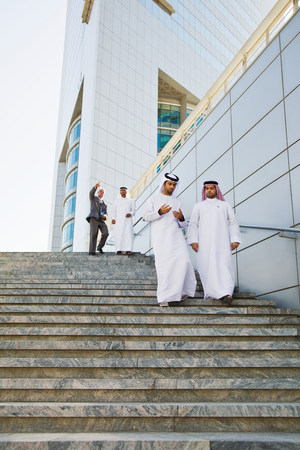 age 40 45 years: Businessmen walking down steps LANG_EVOIMAGES