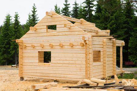 housebuilding: Wooden cabin under construction LANG_EVOIMAGES