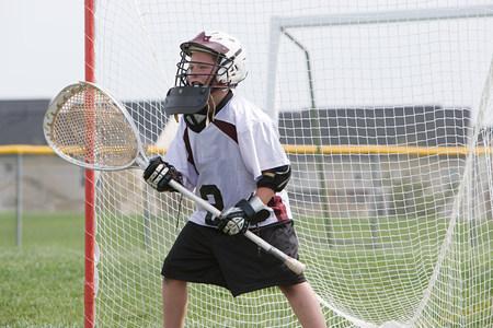Junior lacrosse player in goal LANG_EVOIMAGES