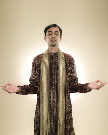 'eyes shut: A hindu man meditating