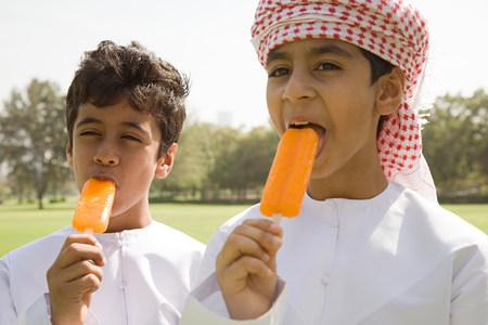Two boys having ice lollies