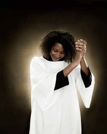A gospel singer clapping LANG_EVOIMAGES