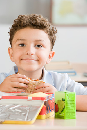 Schoolboy with packed lunch LANG_EVOIMAGES