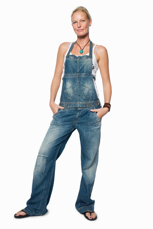 looking at viewer: Woman in dungarees