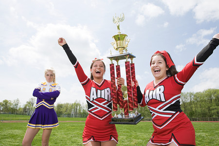 Cheerleaders with trophy