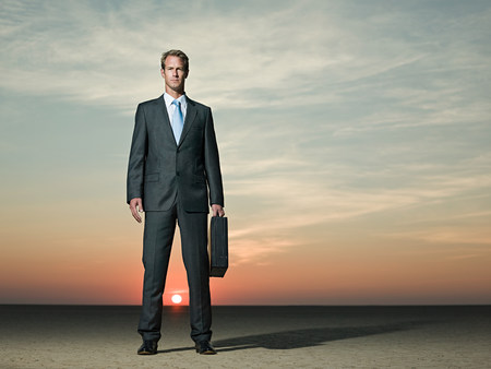 dry suit: Businessman standing in the desert