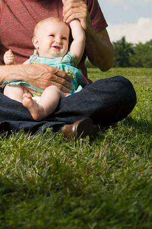 sweet grasses: Father with baby girl on lap