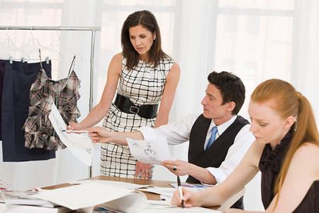 indicate: Fashion designers in meeting