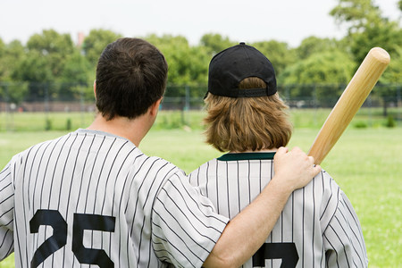 Father and son on baseball field