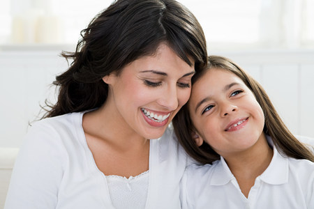 Portrait of an hispanic mother and daughter LANG_EVOIMAGES