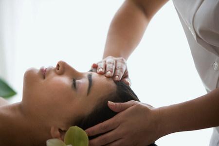 'eyes shut: Woman having a head massage
