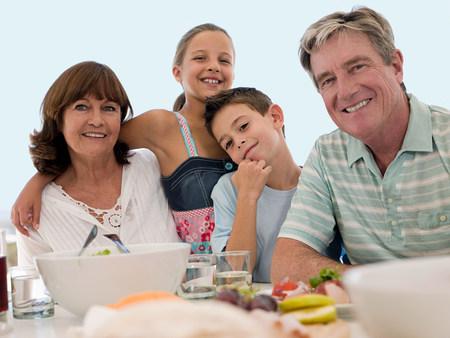 Grandparents and grandchildren at meal LANG_EVOIMAGES