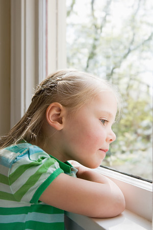 curiousness: Girl looking out of window