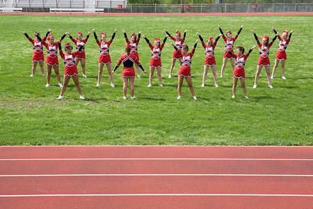 16 to 17 years old: Cheerleaders performing routine