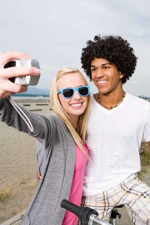 chic woman: Teenage couple with digital camera