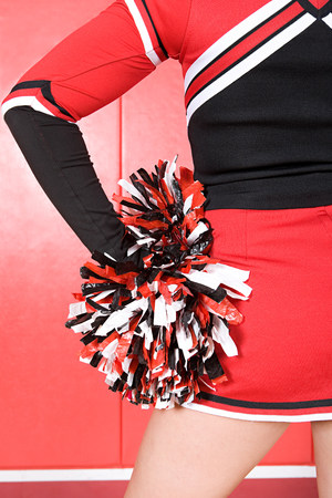 black cheerleader: Cheerleader with pom pom LANG_EVOIMAGES